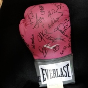 Glove signed by the cast of Rocky.