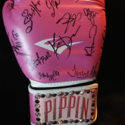 Glove signed by the cast of Pippin.