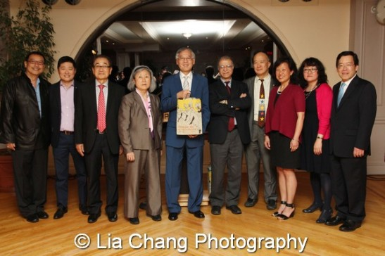 Cao K. O is flanked by past and current Federation board members. (L-R) Paul Huang (past), Khee Lee, Dong Suk Suh (past), Grace Lyu Volckhausen, Muzaffar Chishti, Richard Hsia (past), Marjorie Hsu, Jo-Ann Yoo, Interim Executive Director, AAF, and George H. Wang. Photo by Lia Chang