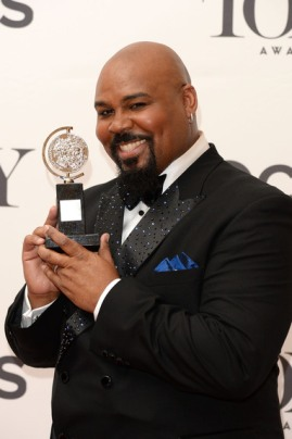 "James Monroe Iglehart, winner of the Tony Award for the Best Performance by an Actor in a Featured Role in a Musical for ""Aladdin"" poses in the press room during the 68th Annual Tony Awards on June 8, 2014 in New York City. (Photo by Andrew H. Walker/Getty Images for Tony Awards Productions)"