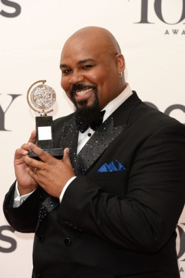 """James Monroe Iglehart, winner of the Tony Award for the Best Performance by an Actor in a Featured Role in a Musical for """"Aladdin"""" poses in the press room during the 68th Annual Tony Awards on June 8, 2014 in New York City. (Photo by Andrew H. Walker/Getty Images for Tony Awards Productions)"""