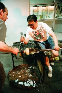 Arlan Huang sculpting a glass vessel in Brooklyn in 1999. Photo by Lia Chang