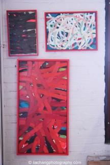 Paintings by artist Arlan Huang in his Brooklyn Studio. Photo by Lia Chang