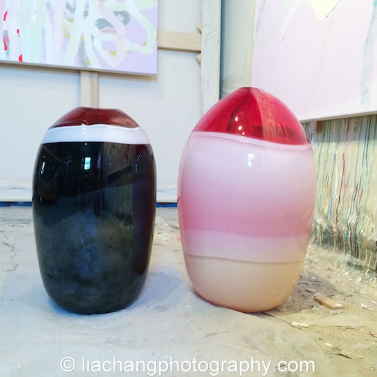 Paintings and blown glass vessels by artist Arlan Huang in his Brooklyn Studio. Photo by Lia Chang