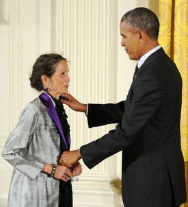 President Barack Obama presents the National Medal of Arts to novelist, poet, and essayist Julia Alvarez in a White House ceremony on July 28, 2014. Photo by Jocelyn Augustino.