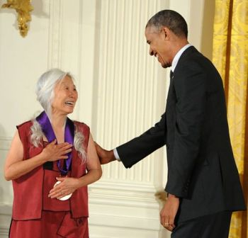 President Barack Obama presents the National Medal of Arts to writer Maxine Hong Kingston in a White House ceremony on July 28, 2014. Photo by Jocelyn Augustino.