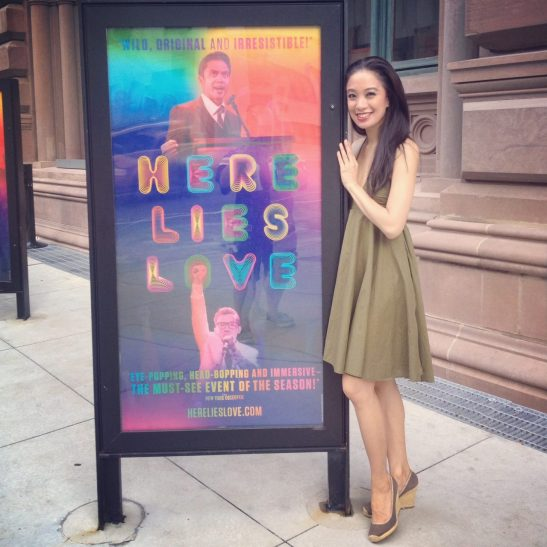 Jaygee Macapugay poses with a poster of Here Lies Love in front of The Public Theater, where she is starring as Imelda Marcos through August 23, 2014.