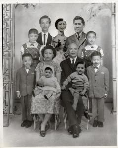 Low family portrait, ca. 1961. Adapting to the immigration laws that kept them apart, a local photography studio helped the Low family of New York create an impossible family portrait by pasting in the faces of missing relatives. CREDIT LINE: Courtesy of Museum of Chinese in America (MOCA) Collection.