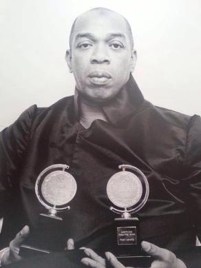 Geoffrey Holder with his Tony Awards for Best Direction of a Musical and Best Costume Design. Photo courtesy of Richard Cameron's Facebook Page.
