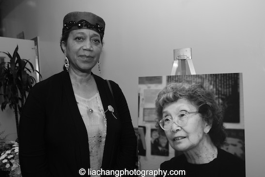 Ambassador Attalah Shabazz poses with a photo of the late Yuri Kochiyama. Photo by Lia Chang
