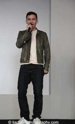 """Conrad Ricamora sings """"A Child of the Philippines"""" at the Here Lies Love Apple Store Soho Event in New York on October 25, 2014. Photo by Lia Chang"""