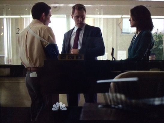 Garth Kravits as a loan office with Agent Ressler and Agent Keen in a scene from the Blacklist. Photo by Lia Chang