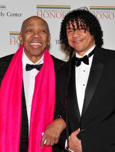 (AFP OUT) Geoffrey Holder and his son, Leo Holder, arrive for the formal artist's dinner for the Kennedy Center Honors at the United States Department of State December 4, 2010 in Washington, D.C. (December 3, 2010 - Source: Pool/Getty Images North America)