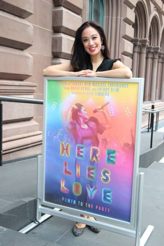 Jaygee Macapugay poses with a poster of Here Lies Love in front of The Public Theater in New York, where she will assume the leading role of Imelda Marcos beginning October 20, 2014. Photo by Lia Chang