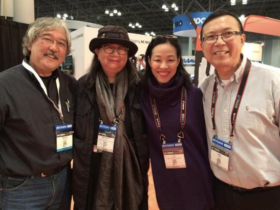 National Geographic photographer Michael Yamashita, Marilynn K. Yee, Lia Chang and Michael Quan at the PhotoPlus Expo 2014 at the Jacob Javits Center in New York on October 31, 2014.
