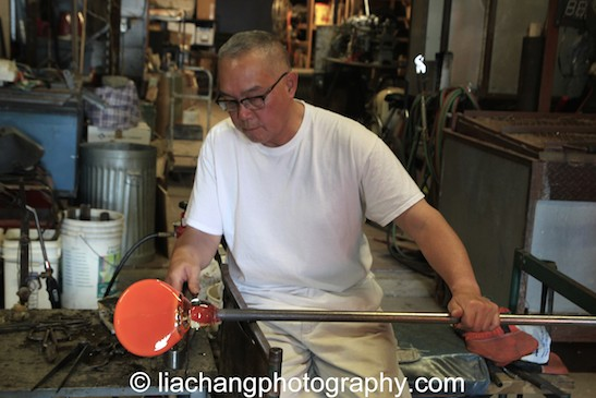Arlan Huang in the Scanlan Glass Blowing Facility. Photo by Lia Chang
