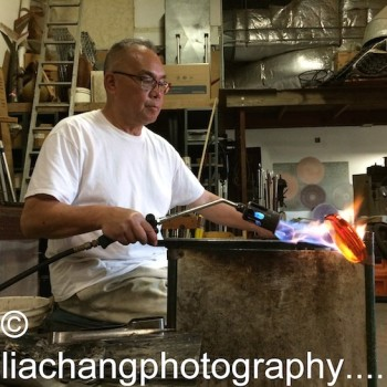 Artist Arlan Huang uses a torch during the glass blowing process at Scanlan Glass at Pier Glass in Red Hook on November 18, 2014. Photo by Lia Chang