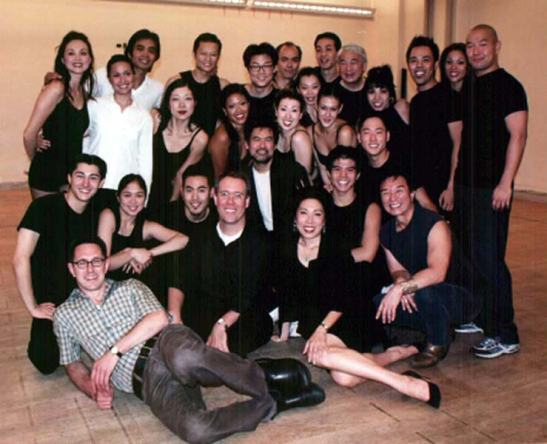 The cast and creative team of David Henry Hwang's revisal of Flower Drum Song in rehearsal in 2002. Photo by Lia Chang