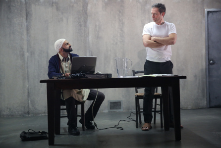 Usman Ally and Justin Kirk in The Invisible Hand. Photo: Joan Marcus