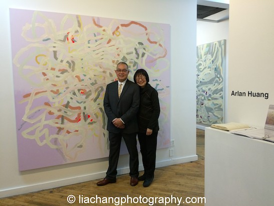 """Trestle Gallery opening reception for """"Swimming Awkward Moment,"""" new works by Arlan Huang, here with his wife Lillian Huang, in Brooklyn on February 20, 2015. Photo by Lia Chang"""