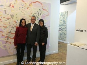 "Lia Chang, Artist Arlan Huang and his wife Lillian Ling at the opening reception of ""Swimming Awkward Moment,"" at Trestle Gallery in Brooklyn on February 20, 2015. Photo by GK"