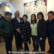 """Trestle Gallery opening reception for """"Swimming Awkward Moment,"""" new works by Arlan Huang, seen here with family members, in Brooklyn on February 20, 2015. Photo by Lia Chang"""