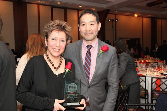 2015 Justice in Action Award recipient Jessica Hagedorn with presenter Andrew Hsiao, senior editor at Verso Books at the Asian American Legal Defense and Education Fund's lunar new year gala at Pier Sixty at Chelsea Piers in New York on February 23, 2015. Photo by Lia Chang