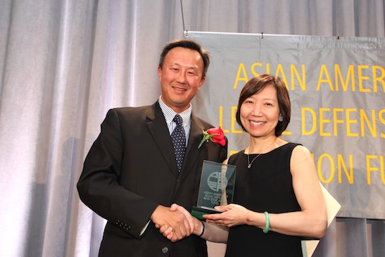 2015 Justice in Action honoree John W. Kuo, Senior Vice President and General Counsel of Varian Medical Systems, with presenter former Justice in Action honoree Sandra Leung, general counsel for Bristol-Myers Squibb at the Asian American Legal Defense and Education Fund's lunar new year gala at Pier Sixty at Chelsea Piers in New York on February 23, 2015. Photo by Lia Chang