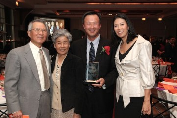 2015 Justice in Action honoree John Kuo is flanked by his parents and his sister Vivian at the Asian American Legal Defense and Education Fund's lunar new year gala at Pier Sixty at Chelsea Piers in New York on February 23, 2015. Photo by Lia Chang