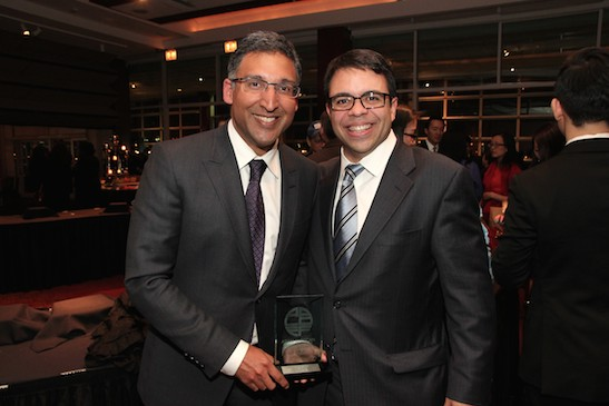 2015 Justice in Action honoree Neal Katyal, partner at Hogan Lovells, Paul Saunders Professor at Georgetown University, and former Acting Solicitor General of the United States with presenter Debo Adegbile, partner at WilmerHale and former litigator at the NAACP Legal Defense Fund at the Asian American Legal Defense and Education Fund's lunar new year gala at Pier Sixty at Chelsea Piers in New York on February 23, 2015. Photo by Lia Chang