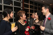 2015 Justice in Action honoree Jessica Hagedorn with her daughters and presenter Andy Hsiao at the Asian American Legal Defense and Education Fund's lunar new year gala at Pier Sixty at Chelsea Piers in New York on February 23, 2015. Photo by Lia Chang