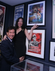 Lia Chang with her fellow Big Trouble in Little China castmate Peter Kwong (Rain) in front of the French poster of Big Trouble in Little China at the opening reception for Hollywood Chinese: The Arthur Dong Collection, at the Chinese American Museum in Los Angeles on October 23, 2009.© Tami Chang