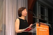 Former Justice in Action honoree Sandra Leung, general counsel for Bristol-Myers Squibb, presented the award to Kuo at the Asian American Legal Defense and Education Fund's lunar new year gala at Pier Sixty at Chelsea Piers in New York on February 23, 2015. Photo by Lia Chang