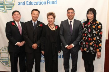 AALDEF board president Tommy Shih, 2015 Justice in Action Award Recipients John W. Kuo, Senior Vice President and General Counsel of Varian Medical Systems, Jessica Hagedorn, novelist, poet, and playwright, and Neal Katyal, partner at Hogan Lovells, Paul Saunders Professor at Georgetown University, and former Acting Solicitor General of the United States and AALDEF executive director Margaret Fung at the Asian American Legal Defense and Education Fund's lunar new year gala at Pier Sixty at Chelsea Piers in New York on February 23, 2015. Photo by Lia Chang