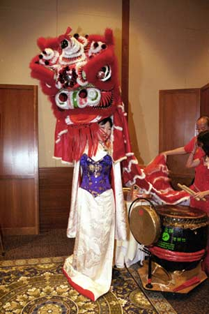 Margaret Cho kicks off the AALDEF's Year of the Ram festivities by raising the lion head to a loud drum roll Photo Credit: Lia Chang