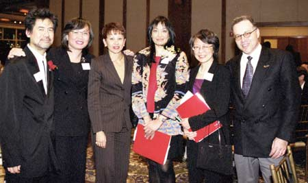 Guests at the 2003 AALDEF dinner (l-r): David Henry Hwang, June Jee of Verizon, Congresswoman Nydia Velazquez, AALDEF executive director Margaret Fung, AALDEF assistant director Lillian Ling, and Paul Bader. Photo Credit: Lia Chang