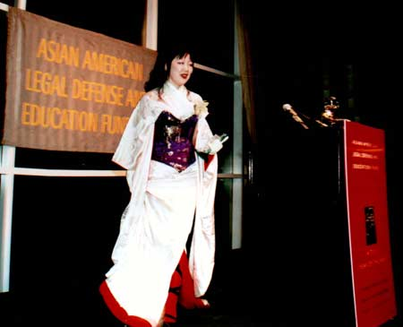 "Margaret Cho accepts AALDEF 2003 ""Justice in Action"" award, for her wildly inventive use of comedy to challenge racism, sexism and social injustice. Photo Credit: Lia Chang"