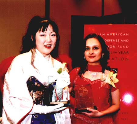 "AALDEF 2003 ""Justice in Action"" award honorees Margaret Cho and Bhairavi Desai of the New York Taxi Workers Alliance.  Photo Credit: Lia Chang"