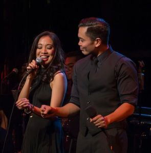 Jaygee Macapugay and Jose Llana sing Child of the Phillipines from Here Lies Love in the Stanley H. Kaplan Penthouse on March 12, 2015. Photo by Kevin Yatarola