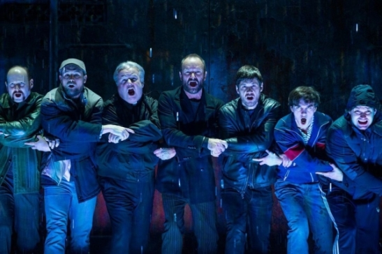 Sting (center) stars as Jackie White in his musical The Last Ship, with a book by John Logan and Brian Yorkey and direction by Joe Mantello, at the Neil Simon Theatre. (© Matthew Murphy)