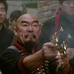 Gerald Okamura as a Wing Kong Hatchet Man in BIG TROUBLE IN LITLE CHINA