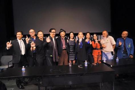 A Big Trouble in Little China reunion with Peter Kwong, screenwriter Gary Goldman, James Lew, George Cheung, James Hong, Lia Chang, Gerald Okamura, Jeff Imada, Joycelyn Lew, Al Leong and Eric Lee at JANM's Tateuchi Democracy Forum in LA on April 8, 2015. Photo by Tami Chang.