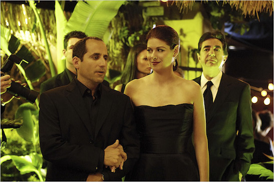 Peter Jacobson, left, Debra Messing and Joe Mantegna in the USA mini-series, The Starter Wife. (2007) Paul A. Broben/USA Network