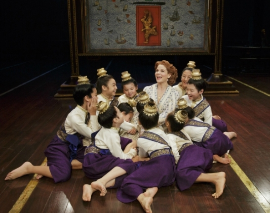 Kelli O'Hara (center) and company. Photo by Paul Kolnik