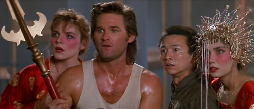 Kim Cattrall, Kurt Russell, Dennis Dun and Suzee Pai in Big Trouble in Little China (1986) (c) Twentieth Century Fox