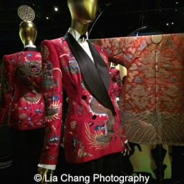 Gallery View Anna Wintour Costume Center, Imperial China. Ralph Lauren (American, born 1939), Ensemble, autumn/winter 2011–12 Jacket of red silk shantung and black silk satin embroidered with polychrome silk and gold metallic thread; shirt of white cotton broadcloth; pants of black and white pinstriped wool-synthetic twill, Courtesy of Ralph Lauren Collection; Chinese Theatrical costume Made during the Reign of the Qianlong Emperor, 1736-95, Red silk satin brocaded with polychrome silk thread, Courtesy of the Palace Museum, Beijing. Photo by Lia Chang