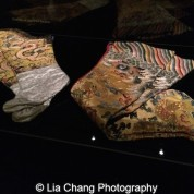 Chinese Padded stockings, 1662-1722, Yellow and white silk tabby embroidered with polychrome silk and metallic thread Courtesy of The Palace Museum, Beijing. Jean Paul Gaultier (French, born 1952). Socks, autumn/winter 2010-11 Yellow silk satin embroidered with polychrome silk thread Courtesy of Jean Paul Gaultier. Photo by Lia Chang