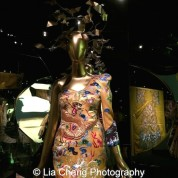 """Laurence Xu's """"Dragon Robe"""" dress, 2011, Yellow silk satin embroidered with polychrome silk and metal thread, Courtesy of Victoria and Albert Museum, London. Given by Laurence Xu. Photo by Lia Chang"""