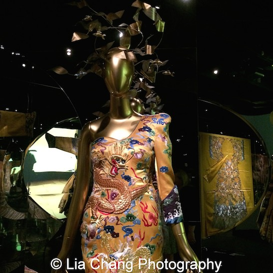 "Laurence Xu's ""Dragon Robe"" dress, 2011, Yellow silk satin embroidered with polychrome silk and metal thread, Courtesy of Victoria and Albert Museum, London. Given by Laurence Xu. Photo by Lia Chang"