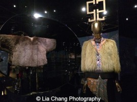 Chinese Coat for the Qianlong Emperor, 1736-95 Yellow silk damask and fur, Courtesy of The Palace Museum, BeijingDries Van Noten (Belgian, born 1958), Ensemble, autumn/winter 2012–13, Coat of yellow fox fur; jacket of polychrome printed wool-silk hammered satin; shirt of polychrome printed silk satin; pants of black wool twill, Courtesy of Dries Van Noten Archive. Photo by Lia Chang